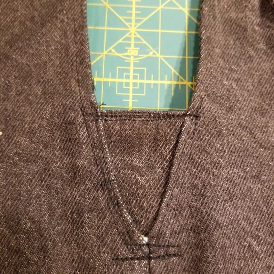 Inserting a piece to sleeve opening to reduce armhole size.