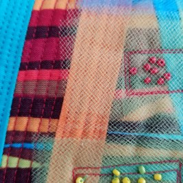 Strip piecing, machine quilting, tulle and bead embellishments